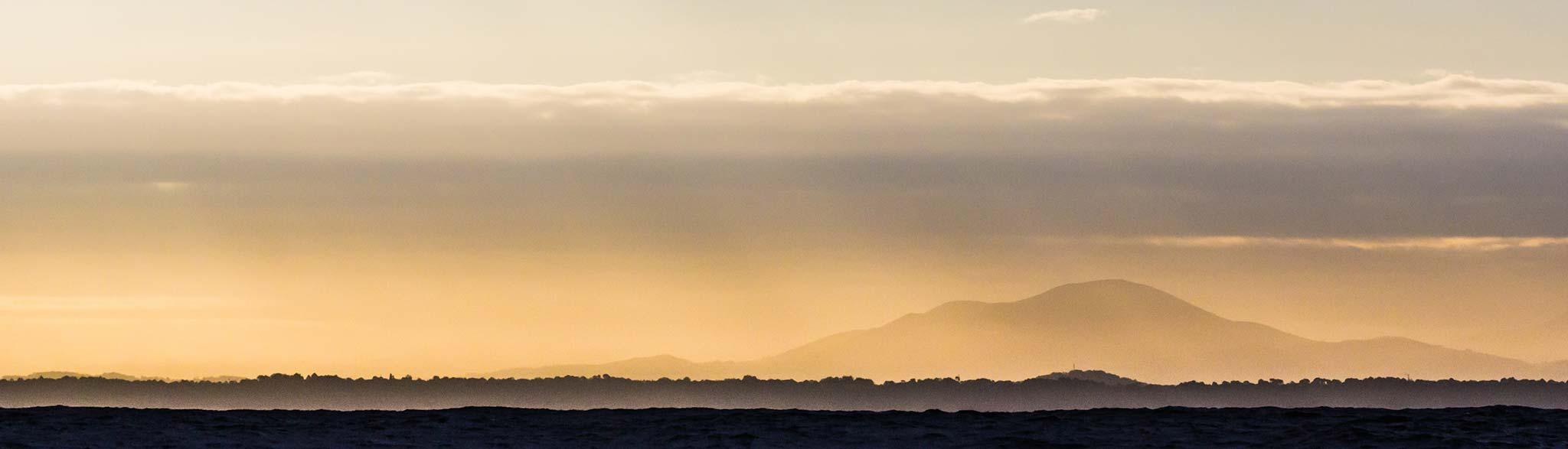 Sonnenuntergang am Ozean von thibault-mokuenko auf unsplash.com